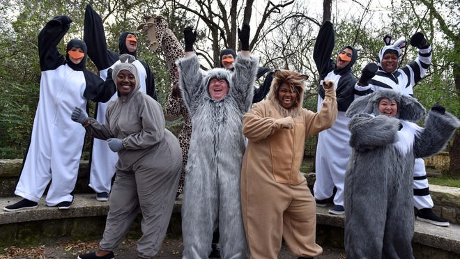 """Members of the New Stage Theater cast of the upcoming performance of """"Madagascar — The Musical Adventure"""" pose for promotional photographs in costume at the Jackson Zoo."""
