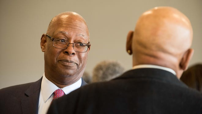 Retired  Judge Lawrence M. Lawson,   an award recepient at the first  Monmouth County Democrats Black America Caucus award luncheon  at The Jumping Brook Country Club, Neptune, chats with Mike Johnson of Neptune .