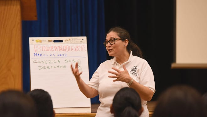 """Diana Mejia with Wind of the Spirit leads a """"Know Your Rights"""" parent workshop at Hackensack High School."""