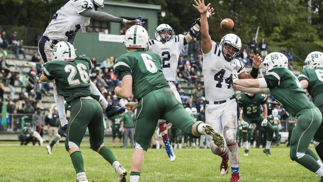 Rice quarterback Tre Diemer (6) almost gets his pass blocked during the high school football game between the Burlington Seahorses and the Rice Green Knights at Rice High School on Saturday afternoon.