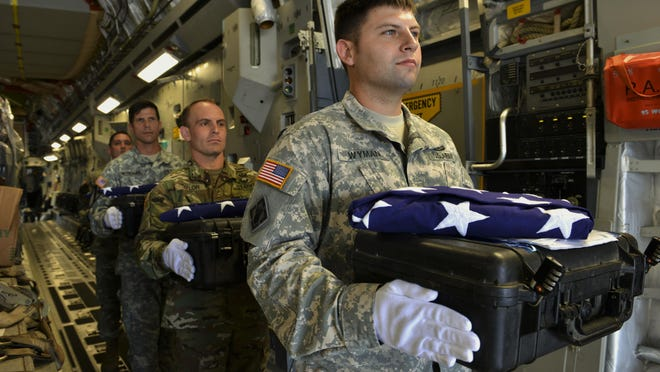 A detail of Defense POW/MIA Accounting Agency personnel carry cases containing possible remains of unidentified service members during a dignified transfer June 16, 2016, at Joint Base Pearl Harbor-Hickam, Hawaii.
