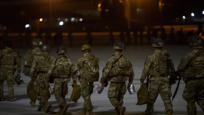 Paratroopers from 2nd Batallion, 504th Parachute Infantry Regiment, 1st Brigade Combat Team, 82nd Airborne Division board a C-17 aircraft Jan. 1 on Fort Bragg. The soldiers were activated and deployed in response to the increased threat levels against U.S. personnel and facilities in Iraq.
