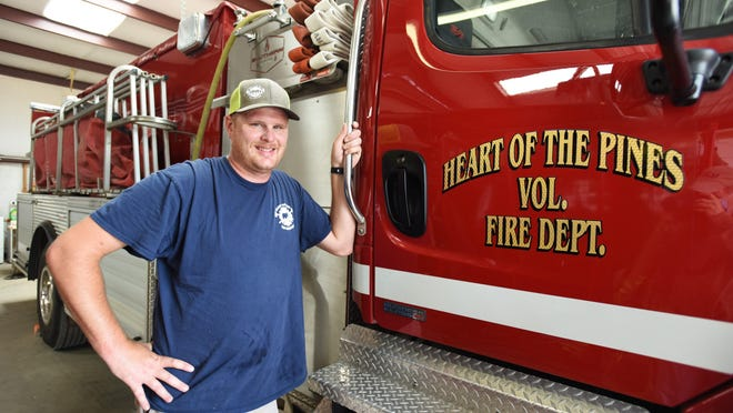Travis Ward, a firefighter with the Heart of the Pines Volunteer Fire Department, said he was inspired to become a volunteer firefighter after an off-duty firefighter stayed by his side during a pin-in from a near-fatal wreck.