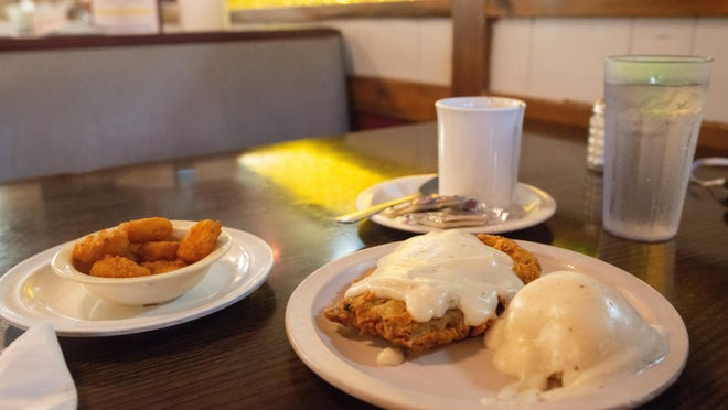 The chicken fried steak dinner at Chic-A-Dee Cafe, 3036 S.E. 6th Ave., comes with mashed potatoes, vegetables and choice of soup or salad for $9.30. Sides shown here are chili, mashed potatoes and corn nuggets.