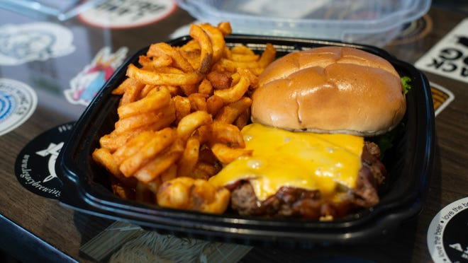 The Wagon Wheel burger at Jeremiah Bullfrogs comes with hickory sauce brushed onto the patty and is topped with bacon and American cheese. A side of seasoned curly fries is a great way to complete the dish for $9.45.