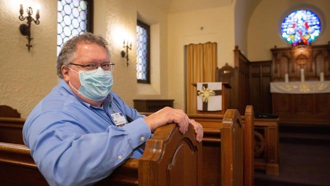 The Rev. Ken Wish, a veteran chaplain at Stormont Vail Hospital, takes a seat on a pew Friday morning in the chapel at Stormont Vail. Wish has been meeting with COVID-19 patients virtually during the pandemic.