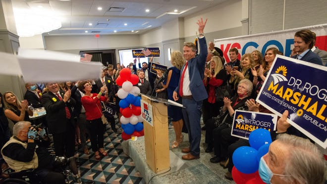 U.S. Rep. Roger Marshall throws his speech in the air Tuesday at the Cyrus Hotel in Topeka after defeating state Sen. Barbara Bollier in the U.S. Senate race.