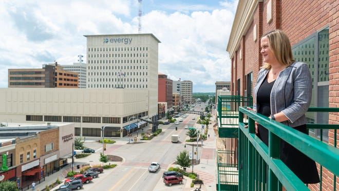 Katrin Bridges, senior vice president of innovation for the Greater Topeka Partnership, looks over downtown from the balcony of the GTP offices Wednesday afternoon. Bridges has been a key player on Topeka's end in bringing the Plug and Play accelerator program to fruition.