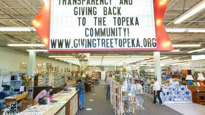 Upon entering The Giving Tree thrift shop, at 3343 S.W. Topeka Blvd., a big red arrow sign alerts customers to the nonprofit's core values: dedication to transparency and giving back to the community. The Giving Tree opened last month and plans to donate profits quarterly to local nonprofits in need.