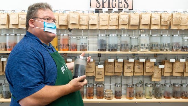 Al Struttman, co-owner of Moburts Spices and More at 820 S. Kansas Ave., holds a bulk container of Urfa biber, a Turkish chili powder, Thursday at his store.