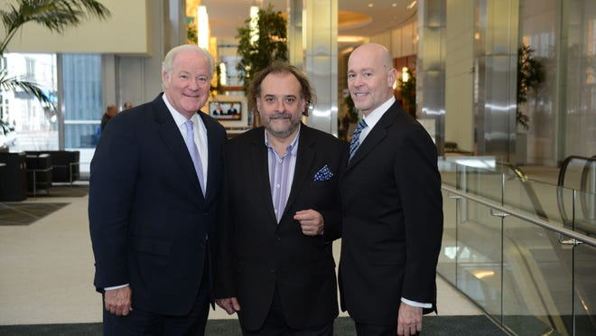 From left: John Barrett, President, Western & Southern, Jean-Robert de Cavel and Richard Brown, in the lobby of Queen City Square
