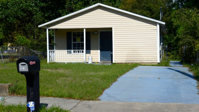 "Cash problems have prompted Pensacola Habitat for Humanity to sell 20 foreclosed houses and vacant lots, like this one located at 218 North Devilliers Street, in a ""bundle"" to a for-profit buyer."