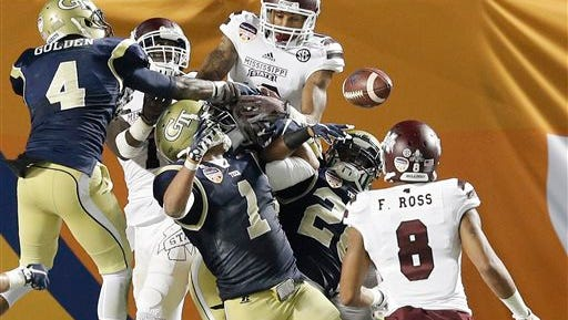A pass bounces off of a jumble of players and is eventually retrieved by Mississippi State wide receiver Fred Ross (8) for a touchtown during the first half of the Orange Bowl NCAA college football game after the game, Wednesday, Dec. 31, 2014 in Miami Gardens, Fla. (AP Photo/Wilfredo Lee)