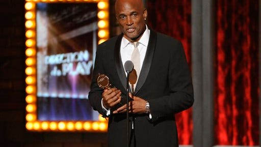 """In this file photo, Kenny Leon receives the award for best direction of a play for """"A Raisin in the Sun"""" on stage at the 68th annual Tony Awards at Radio City Music Hall, in New York. The Dramatists Guild Fund has awarded $170,000 to non-profit theaters across the country, from the established Soho Repertory Theatre in New York City to the Mo'olelo Performing Arts Company in San Diego. The Fund on Thursday announced 129 winners, including Tony Award-winning director Leon's True Colors Theatre Company in Atlanta, as well as Plan B Theatre Company from Salt Lake City and the Spooky Action Theater in Washington, D.C."""