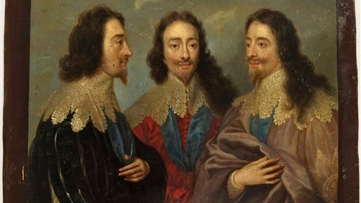 """This image provided by the Monuments Men Foundation shows a copy of a painting titled """"King Charles I in Three Positions Kings,"""" possibly attributed to the school of Anthony an Dyck, oil on copper. The painting, one of five missing since World War II, are being returned to collections in Germany at the behest of the heirs of their American acquirers.  It had been in a castle near Frankfurt that was confiscated by the U.S. military in 1945 and turned into an officers' club. They were purchased by an American woman who was serving in Germany as a librarian in the U.S. Special Services after the war, said the Monuments Men Foundation. (Anna Bottinelli/Monuments Men Foundation via AP)"""