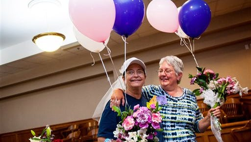 "Barb Sonderman, left, embraces her partner of 17 years Martha Pickens as they wait to have their marriage officiated after the Supreme Court's ruling that same-sex couples have the right to marry in all 50 states on Friday, June 26, 2015, at the Boone County Courthouse in Columbia, Mo. ""We just said let's wait because it's going to happen,"" Sonderman said."