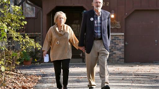 """Patty and Jerry Wetterling walk down their driveway to speak to reporters Tuesday at their home in St. Joseph, Minn. to address the arrest of a """"person of interest"""" in the abduction of their son, Jacob. The Wetterling's were surprised when authorities told them they had identified a person of interest in their son Jacob's abduction 26 years ago. They urged people to keep calling in tips that might finally explain what happened to their son."""
