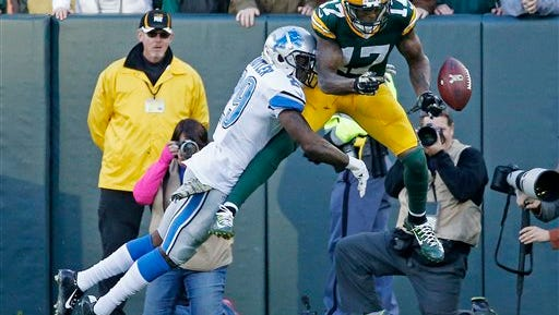 Asheville High alum Crezdon Butler breaks up a 2-point conversion pass on Sunday in Green Bay.