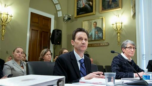 Bureau of Reclamation Deputy Commissioner for Operations David Palumbo, left, and Interior Sally Jewell testify on Capitol Hill in Washington, Wednesday, Dec. 9, 2015, before the House Natural Resources Oversight Committee hearing on the Animas River Spill in Colorado.  (AP Photo/Manuel Balce Ceneta)