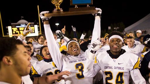 Pittsburgh Central Catholic players celebrate a victory over Parkland High in a PIAA Class AAAA high school football championship game on Saturday in Hershey, Pa.