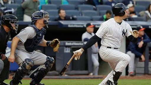 New York Yankees' Mark Teixeira, right, follows through on a three-run home run as Houston Astros catcher Erik Kratz looks on during the seventh inning of a baseball game, Thursday, April 7, 2016, in New York. (AP Photo/Julie Jacobson)