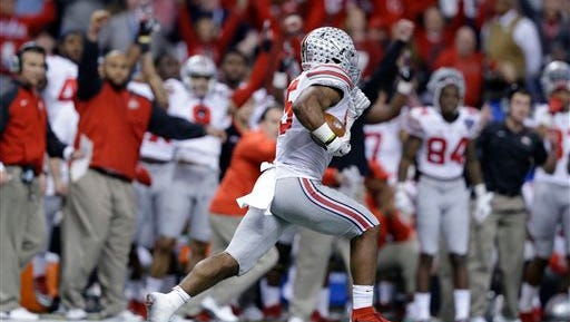 Ohio State running back Ezekiel Elliott (15) runs toward the end zone against Alabama in the second half of the Sugar Bowl NCAA college football playoff semifinal game, Thursday, Jan. 1, 2015, in New Orleans. Elliott scored a touchdown on the play.