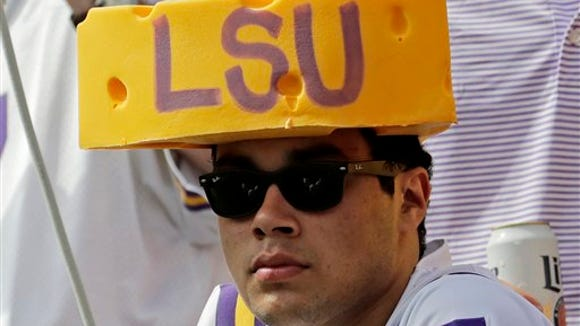 An LSU fan watches from Lameau Field during the first half of an NCAA college football game against Wisconsin Saturday, Sept. 3, 2016, in Green Bay, Wis.