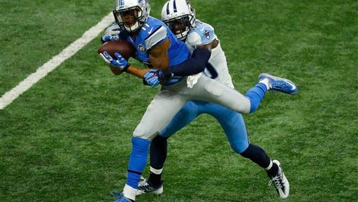 Detroit Lions wide receiver Marvin Jones is tackled by Tennessee Titans cornerback Jason McCourty after a reception during the first half of an NFL football game, Sunday, Sept. 18, 2016, in Detroit. (AP Photo/Paul Sancya)