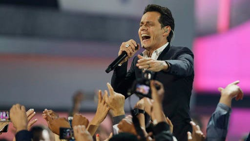 FILE - In this April 24, 2014, file photo, Singer Marc Anthony performs during the Latin Billboard Awards in Coral Gables, Fla. In a gala on the eve of the Latin Grammys in Las Vegas, on Wednesday, November 16, 2016, Marc Anthony will be honored as the Latin Recording Academy's Person of the Year.