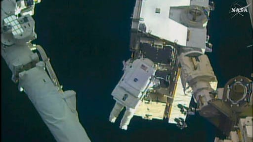 In this still image taken from video provided by NASA, astronaut Peggy Whitson takes a spacewalk outside the International Space Station on Friday, Jan. 6, 2016.  Whitson and Commander Shane Kimbrough went spacewalking  to hook up fancy new batteries on the International Space Station's sprawling power grid.