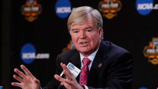"""FILE - In this March 30, 2017, file photo, NCAA President Mark Emmert answers a question at a news conference in Glendale, Ariz.  The NCAA says it will consider North Carolina as a host for championship events again after the state rolled back a law that limited protections for LGBT people. In a statement Tuesday, April 4, 2017, the governing body said its Board of Governors had reviewed moves to repeal repealed the so-called """"bathroom bill"""" and replace it with a compromise law."""