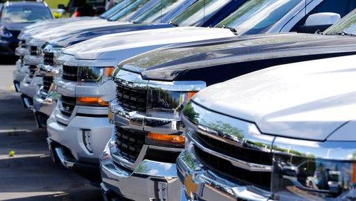 In this Wednesday, April 26, 2017, photo, Chevrolet pickups are lined up at a Chevrolet dealership in Richmond, Va. Analysts expect the auto industry to post a fourth straight month of lower sales as the pace of sales cools after last year's record.