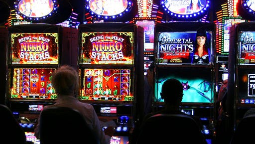 In this May 2, 2017, photo, gamblers play electronic bingo at the Naskila Gaming center, operated by the Alabama-Coushatta Tribe of Texas about 15 miles east of Livingston, Texas. Nearly a year after a relatively small electronic bingo operation quietly opened, Texas officials historically opposed to anything resembling casino-style gambling are in federal court insisting the 365 bingo machines are illegal. (AP Photo/Michael Graczyk)