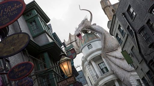 "This photo released by Universal Orlando Resort shows ""The Wizarding World of Harry Potter ? Diagon Alley,"" from the Harry Potter-themed area of Universal Orlando Resort in Orlando, Fla. The attraction, featuring shops, dining experiences and the next generation thrill ride, officially opens on Tuesday."