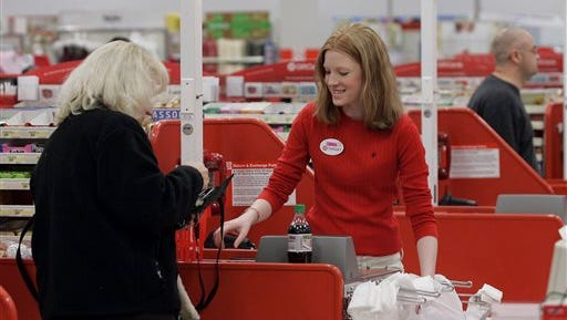 FILE - In this  Friday, Nov. 18, 2005, file photoCashier Nora Poage rings up a purchase at a Target store in Seattle Wash.  A federal appeals court has handed a defeat to a coalition of retail groups that challenged as too high the Federal Reserve's cap on how much banks can charge businesses for handling debit card transactions. The ruling issued Friday, March 21, 2014 by the U.S. Appeals Court for the District of Columbia overturned a lower court's decision in July that favored the merchants and was a setback for banks. (AP Photo/Ted S. Warren, File)