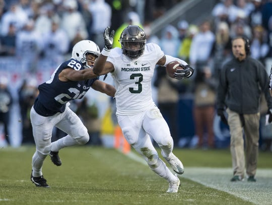 Michigan State Spartans running back LJ Scott carries