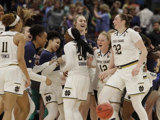 Notre Dame celebrates at the end of a women's Final Four NCAA semifinal game against Connecticut, Friday, April 5, 2019, in Tampa, Fla. Notre Dame defeated Connecticut 81-76.