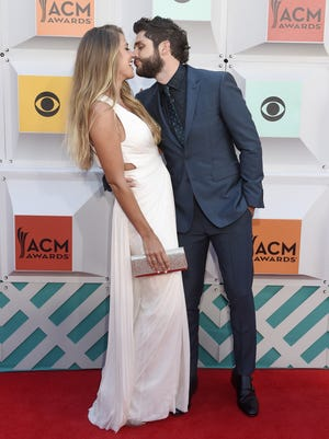 Lauren Gregory, left, with her husband Thomas Rhett, pose on the red carpet at the 51st Academy of Country Music Awards at the MGM Grand Garden Arena on Sunday April 3, 2016, in Las Vegas, NV.