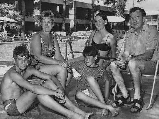 Columnist Erma Bombeck and her family lounge at the