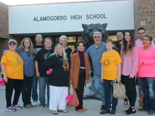 The Alamogordo High School Class of 1969, who donated the first AHS statue, stands with the 2015 and 2016 student council members who donated the newest addition.