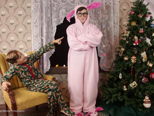 "Lucas Moran as Randy is amused by Ronnie Thom Farrell as Ralphie, who is forced to model bunny PJs on Christmas morning in Lyric's ""A Christmas Story The Musical."""