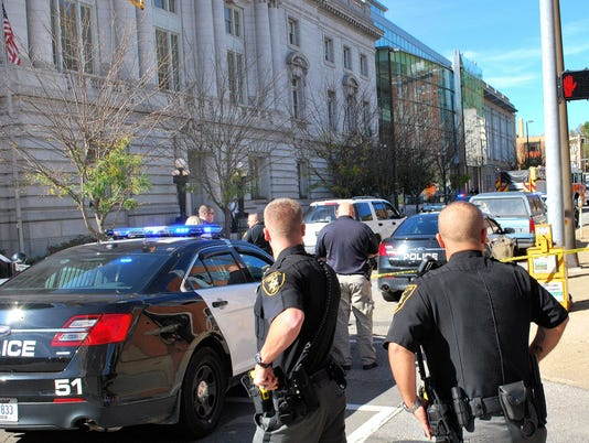 Ex-cop killed after firing at W. Va. federal courthouse