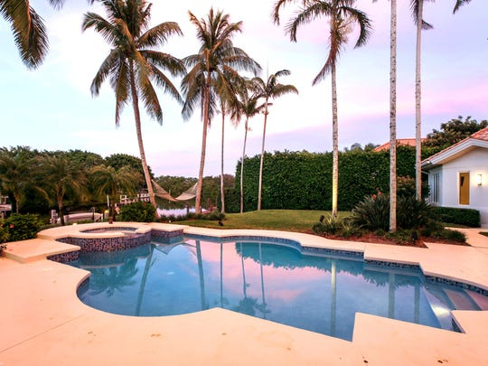 The featured pool area offers a relaxed atmosphere accentuated by the nearby waterway.
