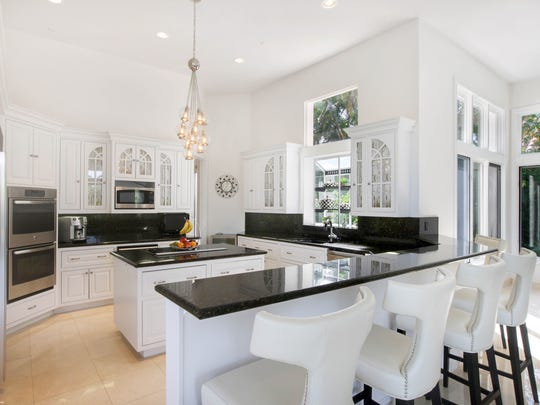 Interior highlights include an open spacious floorplan, a gourmet kitchen with signature appliances, breakfast bar and breakfast nook.