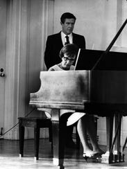 John Cage, composer-in-residence at UC, listens to