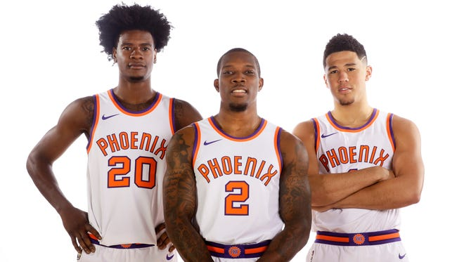 Veteran guard Eric Bledsoe (center) will lead the young 2017 Suns, including rookie forward Josh Jackson (left) and high-scoring shooting guard Devin Booker (right).