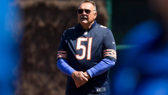 Chicago Bears Hall of Fame linebacker Dick Butkus is recognized before the Arizona Diamondbacks faced the Chicago Cubs on the 100th anniversary of the first baseball game at Wrigley Field on April 23, 2014, in Chicago.