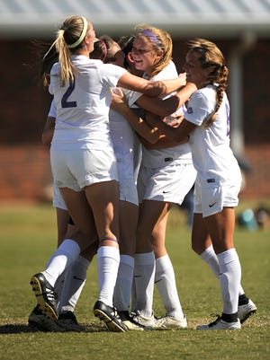 Hardin-Simmons' Kirsten Parrish (16) is congratulated by teammates after scoring a goal in the first half of the Cowgirls' 3-0 win on Tuesday, Nov. 1, 2016, at the HSU Soccer Complex.