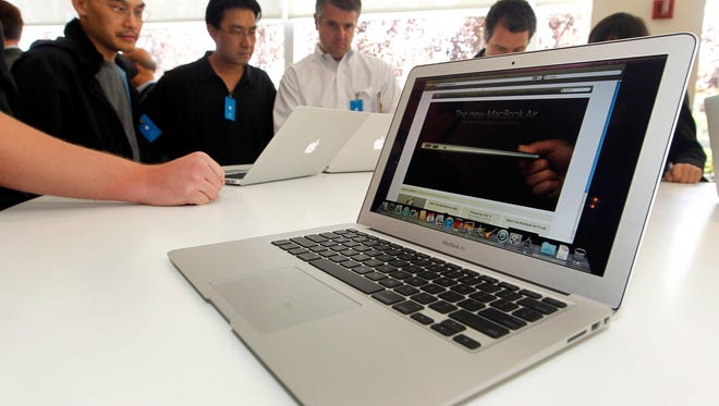 The new Apple Macbook Air laptop is seen on display at Apple headquarters in Cupertino, Calif., Wednesday, Oct. 20, 2010. (AP Photo/Tony Avelar)