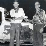 Billy Schroth of Elmira holds the Fall Championship winners trophy he won at Angelica Raceway in the late 1950s. A race official holds a watch that he also received.
